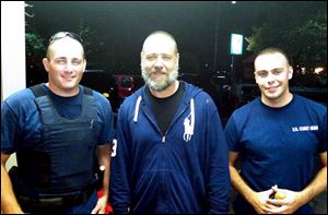 Actor Russell Crowe, center, with Coast Guard petty officers  Robert Swieciki, left,  and Thomas Watson Sunday.  Crowe and a friend became disoriented while kayaking in Long Island Sound Sunday and called the Coast Guard for assistance.