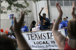 Supporters cheered the Teamsters Local 20 as they marched Monday morning during the Toledo Labor Day Parade. Hundreds of people turned out to see local unions, their supporters and other organizations march to celebrate American workers.