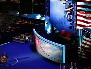 Production crew makes final preparation on the stage for the Democratic National Convention.