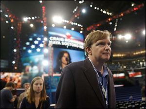 President Barack Obama's campaign manager Jim Messina tours the floor at the Democratic National Convention.