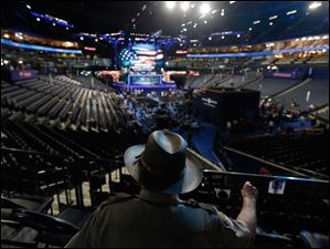 Lt. A.C. Powers of Augusta County Sheriff's from Stanton, Va., looks down on the floor in Time Warner Cable Arena at the Democratic National Convention.