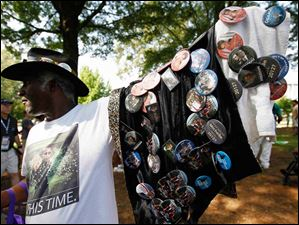 A vendor sells political buttons before the start of the Democratic National Convention.