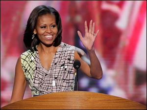 First Lady Michelle Obama waves from the lectern during a sound check at the Democratic National Convention.