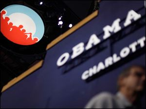 Obama campaign logo is seen under the scoreboard hanging from the ceiling inside of Time Warner Cable Arena.