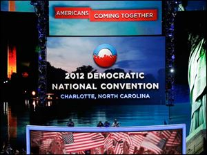 First Lady Michelle Obama performs a sound check on the main stage for the Democratic National Convention.