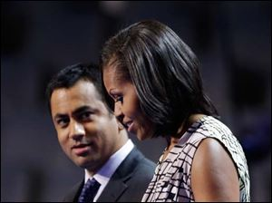 First Lady Michelle Obama appears on the stage with actor Kal Penn for filming a campaign video at the Democratic National Convention.