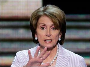 House Minority Leader Nancy Pelosi of California looks over the convention floor during a sound check.
