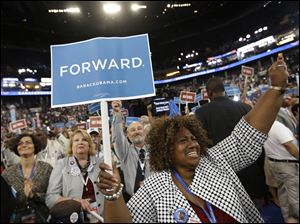 North Carolina delegate Carolyn Bryan from Jacksonville cheers during the Democratic National Convention in Charlotte, N.C.