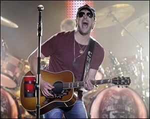 Eric Church performs on an outdoor stage during the CMT Music Awards show in Nashville, Tenn., earlier this summer.
