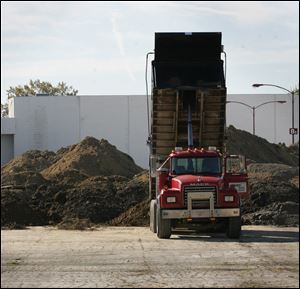 Dirt is dumped behind the former Showcase Cinemas on Secor Road in this 2010 file photo.