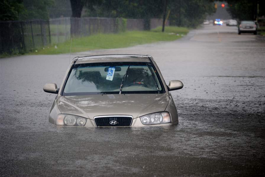A-car-sits-abandoned-in-floodwaters