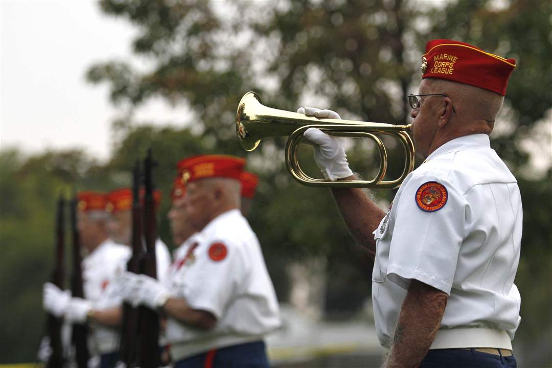Larry-Barnett-plays-TAPS-during-the-annual-Support-the-Troops