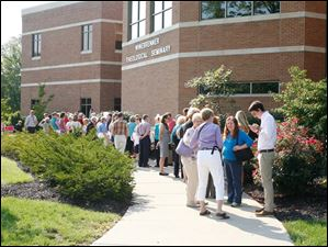 A crowd forms waiting to enter Winebrenner Auditorium at the University of Findlay in Findlay, before Ann Romney speaks during a Women for Mitt rally, Wednesday, September 5, 2012.