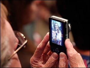 A supporter photographs Ann Romney as she speaks during a Women for Mitt rally at the Winebrenner Auditorium at the University of Findlay in Findlay, Wednesday, September 5, 2012.