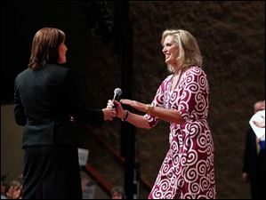 Ohio Lt. Governor Mary Taylor shakes hands with Ann Romney after introducing her during a Women for Mitt rally at the Winebrenner Auditorium at the University of Findlay in Findlay, Wednesday, September 5, 2012.