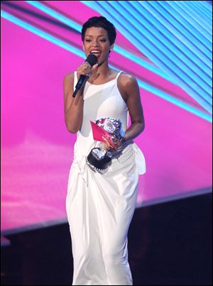 "Rihanna accepts the award for video of the year for ""We Found Love."""