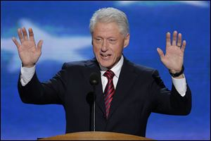 Bill Clinton greets the audience at the Democratic National Convention. His presence Wednesday was in sharp contrast to the absence of former President George W. Bush at the Republican convention a week earlier.