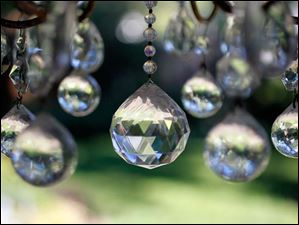 Crystals hang from a chandelier in the backyard.