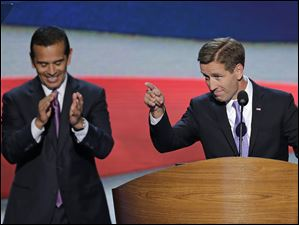 Beau Biden, right, Attorney General of Delaware and son of Vice President Joe Biden, points towards the delegates before his nominates his father during the Democratic National Convention. Los Angeles Mayor and Democratic Convention Chairman Antonio Villaraigosa claps in the background.