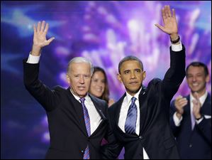 Vice President Joe Biden and President Barack Obama wave to the delegates.