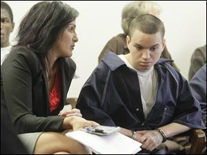 Attorney Nicole Khoury speaks with client Devon Daly in Lucas County Common Pleas Court. Daly received a 14-year prison sentence Thursday in the death of Rory Hunter.