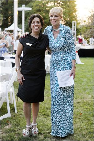 Art & Autism Chair Rita Mansour, left, and host Barbara Steele pose for a photograph at the benefit event For Art and Autism.