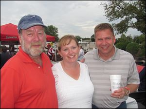 Larry La Point and his nephew and niece-in-law Mike and Julie McAlindon of Vermillion at the Dock B party.