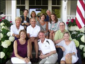 Guests at Debbie Joslin's Harbor Springs, Mich., porch party at L'Abre Croche include, left to right, front to back: Kathy and Jon Miller, Becky Fuhrman, Robyn Barrie, John Joslin, Debbie Joslin, Katherine Joslin, Don Leary, Debbie Chapman, and Mary Sue and John Siciliano.