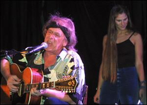 Jefferson Starship's Paul Kantner, left, performs in front of Diana Mangano during the 'Freedom Sings' benefit concert in New York in this June 20, 2001, file photo.