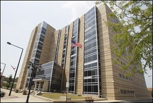 The seven-story, $38 million justice center that opened across the street in 2004 prompted the move of courts out of the old courthouse that year.