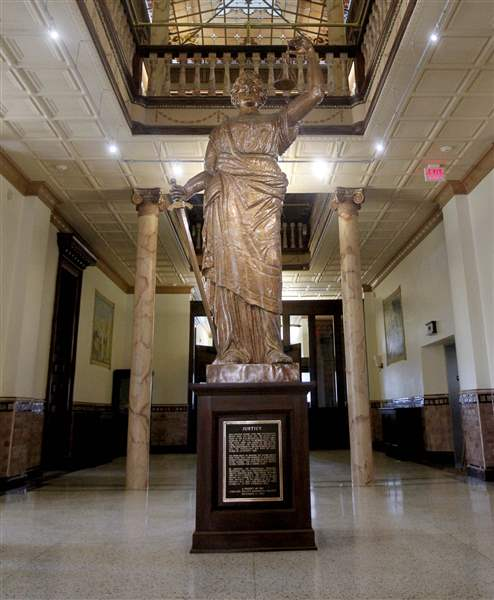A-13-foot-copper-statue-of-Lady-Justice