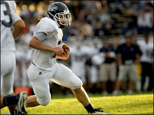 Ben Swartz, of the Lake Flyers, runs the ball during the first quarter of their game against the Northview Wildcats at Northview High School in Sylvania Township, Ohio.