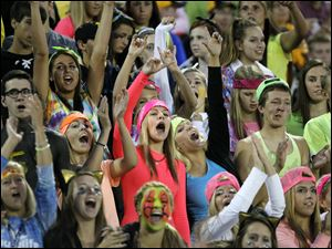 Fans for the Northview Wildcats cheer them on after making a touchdown in the second quarter of their game against the Lake Flyers at Northview High School in Sylvania Township, Ohio, on Saturday.