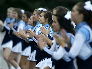 Katie Hotz cheers along side the Lake Flyers Varsity Cheerleading Squad during the first quarter of their game against the Northview Wildcats at Northview High School in Sylvania Township.