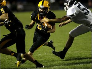 Preston McCurdy, of the Northview Wildcats, runs the ball in for a touchdown during the second quarter of their game against the Lake Flyers at Northview High School in Sylvania Township, Ohio, on Saturday.