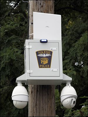 A Toledo police security camera pod at Locus and Ontario streets is a typical installation.