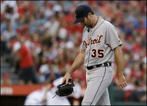 Detroit Tigers starting pitcher Justin Verlander walks to the dugout after giving up four runs to the Los Angeles Angels during the first inning of a baseball game in Anaheim, Calif.