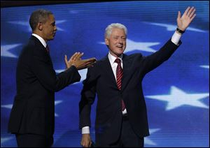 Former President Bill Clinton acknowledges the cheers as President Obama applauds after Mr. Clinton's speech at the Democratic National Convention.