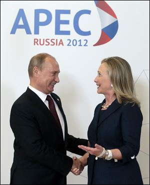 Russian President Vladimir Putin and Hillary Clinton meet at the APEC meeting in Vladivostok.