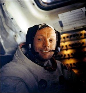 This July 20, 1969, file photo shows Neil Armstrong on the first voyage to land on the moon.