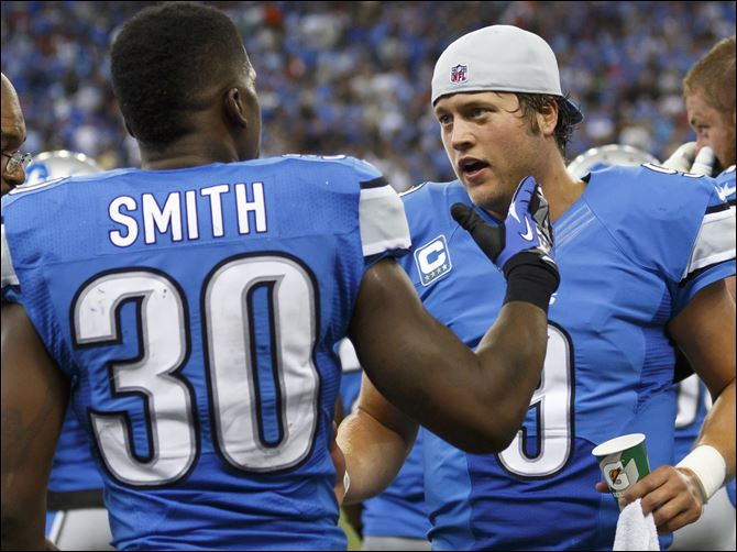 Rams Lions Stafford Detroit Lions running back Kevin Smith, left, receives congratulations from quarterback
