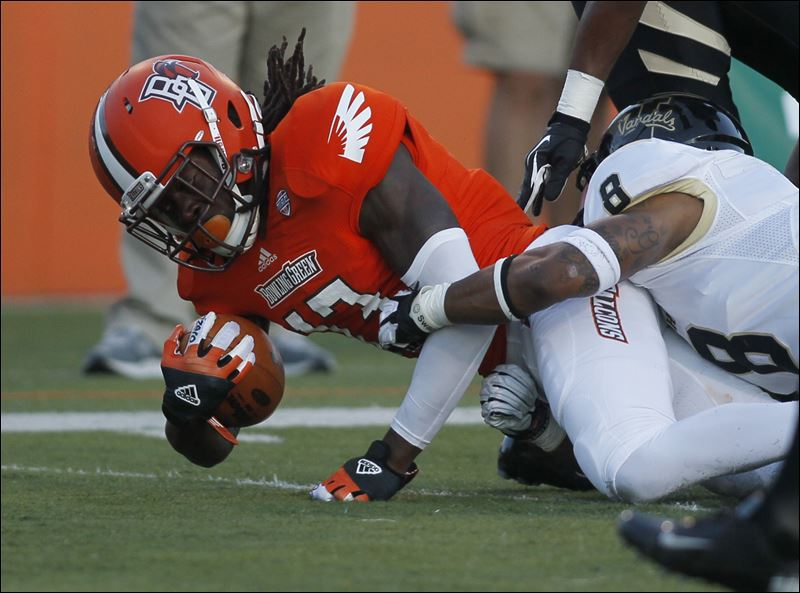 Bowling-Green-s-Travis-Greene-picks-up-a-first-down.jpg