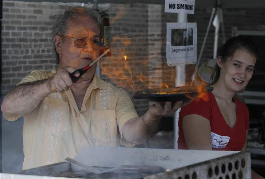 John-Skiadas-makes-saganaki-flaming-cheese