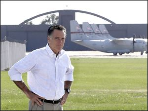 Republican presidential candidate Mitt Romney pauses today after looking at C-27J transport  planes at the airport in Mansfield, Ohio.
