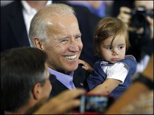 Vice President Joe Biden greets supporters, including a young one, at Milford High School near