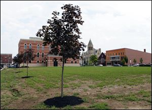 Seneca County's 1884 courthouse site sits barren. Commissioners voted 2-1 to pay $408,000 to raze the historic building earlier this year rather than restore it, a task that would have cost $8 million and involved a low-interest federal loan and the sale of bonds. The county still needs space for juvenile and probate courts and still has no plan.