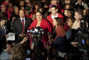 Chicago Teachers Union President Karen Lewis informs reporters at a news conference outside the union's headquarters in Chicago that the city's 25,000 public school teachers will walk the picket line Monday morning after talks with the Chicago Board of Education broke down Sunday evening.