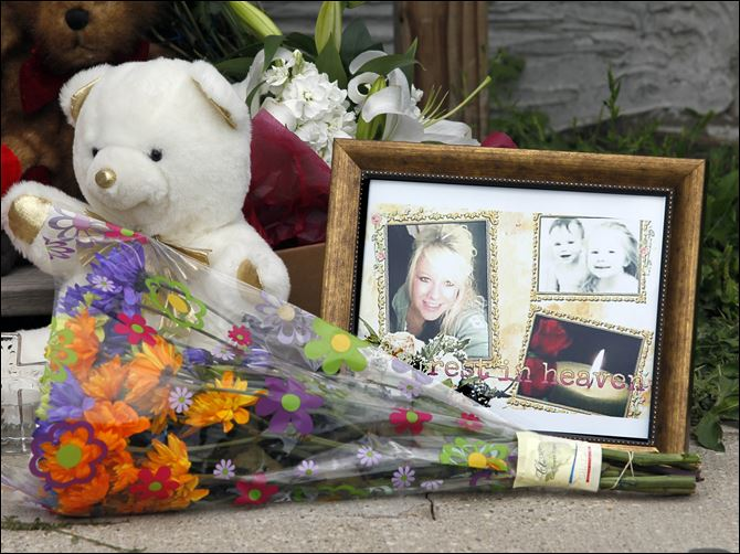 CTY homicide A picture of Heather Jackson, 23, and her two children, Celina Jackson and Wayne Jackson, is nestled among a growing memorial of flowers and stuffed animals outside the home where they were found slain in Sandusky.