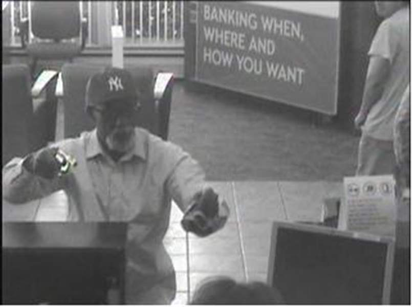 Surveillance-photo-of-armed-robbery