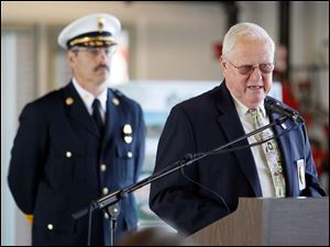 Retired Assistant Chief of the Toledo Fire and Rescue Department  Robert Schwanzl speaks about the history of the bell during a 9/11 Commemoration Ceremony and Dedication of Fire Station 6 at 1155 Oak Street, Tuesday, September 11, 2012.  Behind him is Chief Phillip Cervantes, Asst. Chief of the Toledo Fire and Rescue Department.